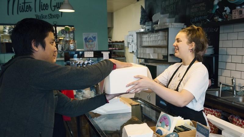 Handing Box To Customer